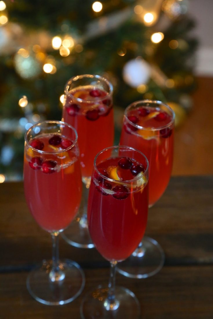 Poinsettia cocktail with a splash and a twist of orange